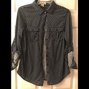 Navy blue with white polka dots. Button down